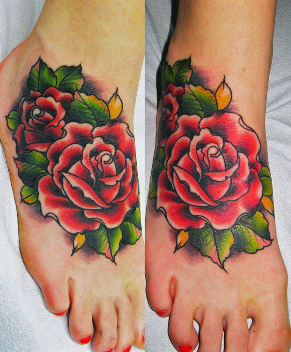 Colorful rose tattoo on foot