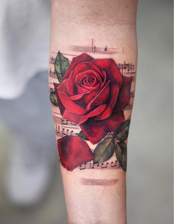 Music Rose tattoo on arm