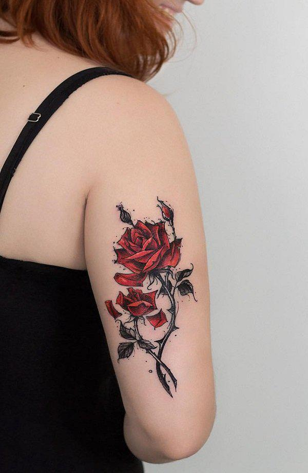 Red rose with hips and horns tattoo