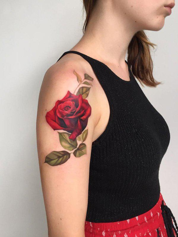 Red rose with grey leaves tattoo