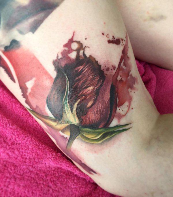 Rose bud thigh tattoo