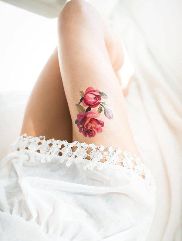 rose-thigh-tatto-96