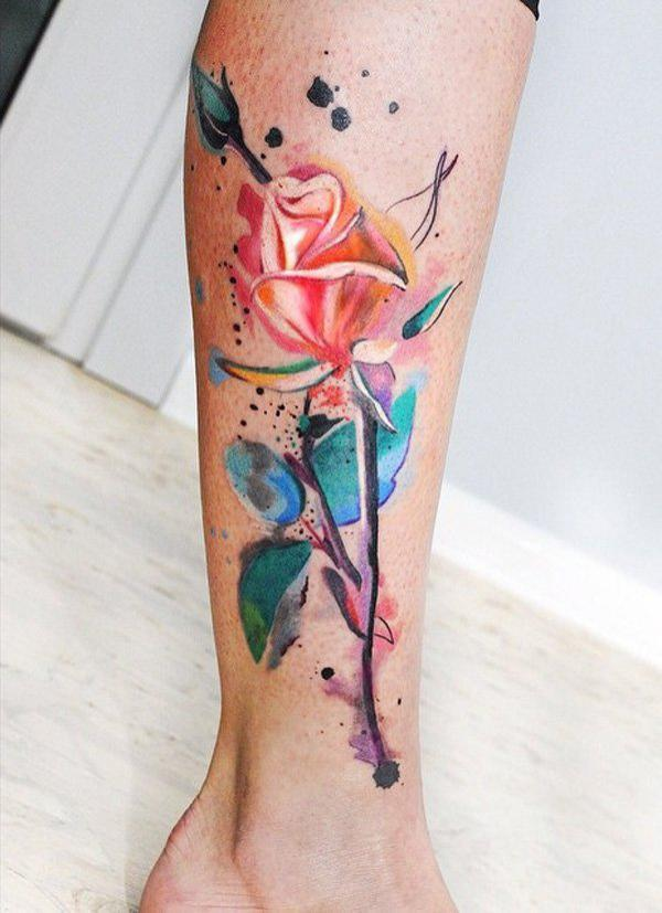 Vibrant one stem rose tattoo in watercolor style