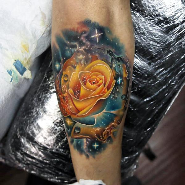 Yellow Rose in Galaxy tattoo on arm