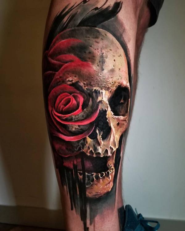 Skull rose tattoo on leg
