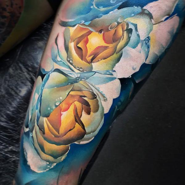 blue and pink with water droplets tattoo
