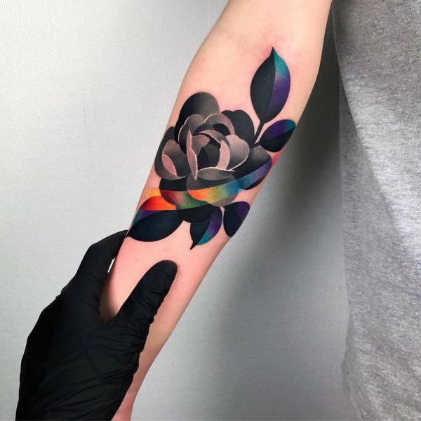 Stylized rose with rainbow stripe tattoo
