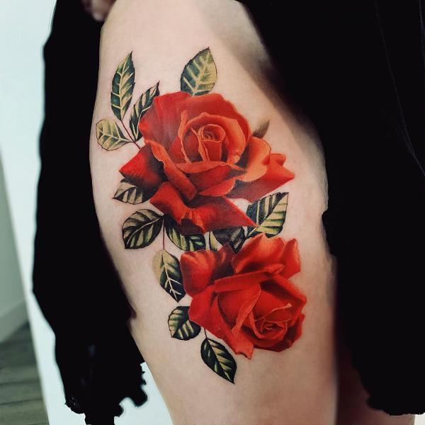 roses tattoo on thigh