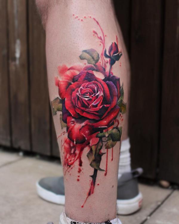 Watercolor rose on calf tattoo