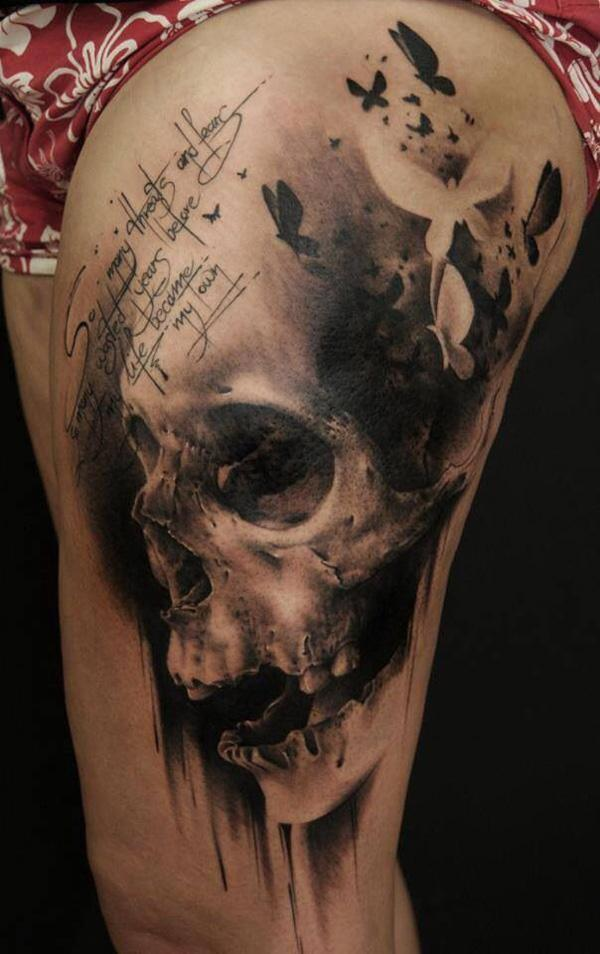 100-Skull thigh tattoo