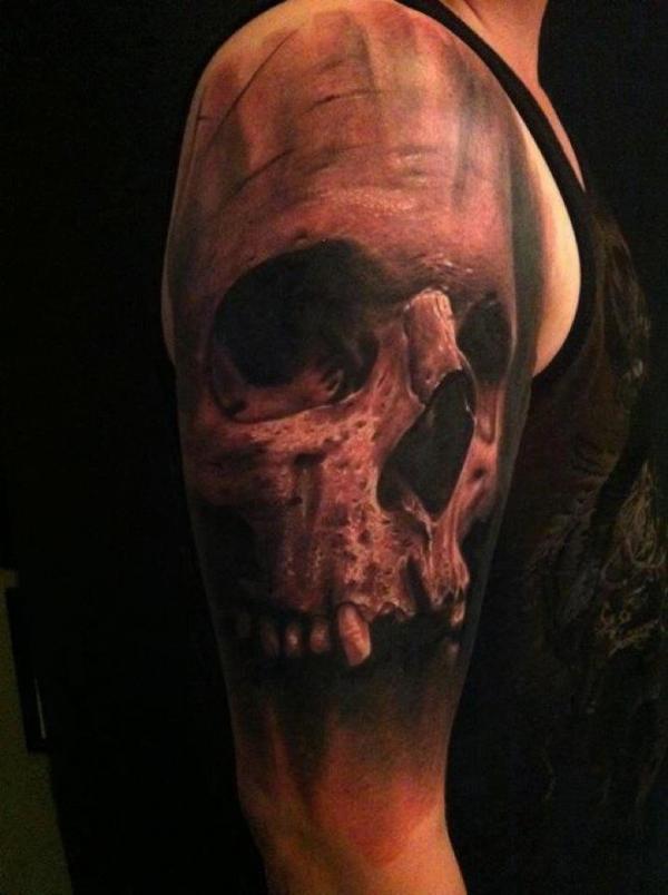Large skull half sleeve tattoo