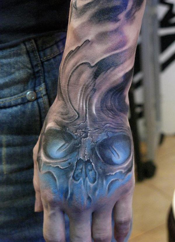 Skull with UV light Tattoo on hand