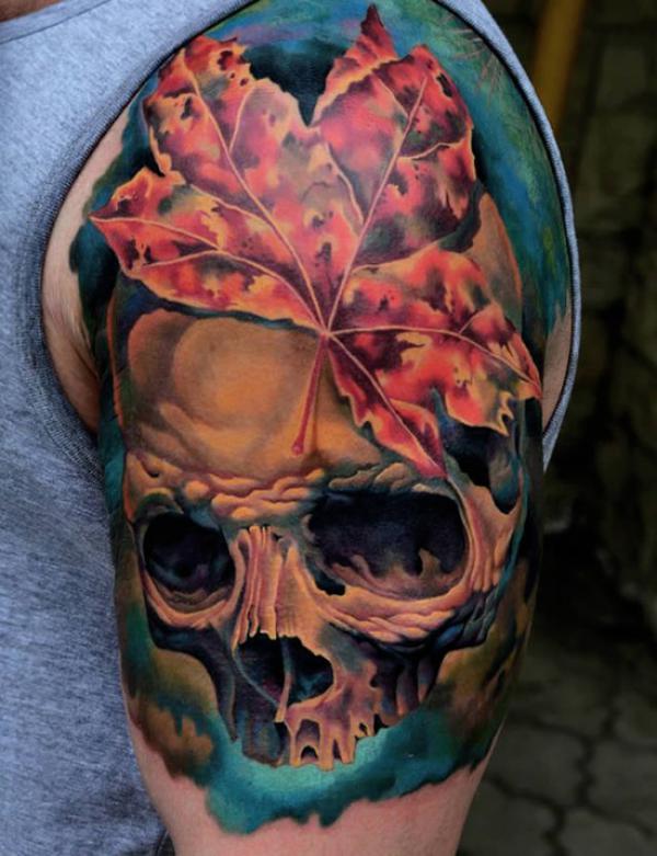 Fall leaf and skull tattoo on arm