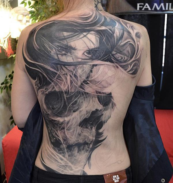63-Girl and skull tattoo on back for woman