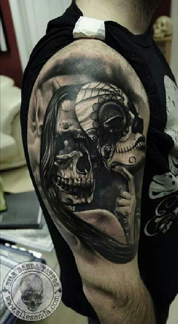 64 Skull with mask tattoo on sleeve