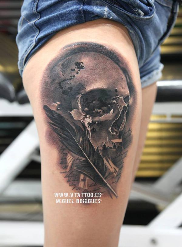 69-Skull with feather tattoo on thigh