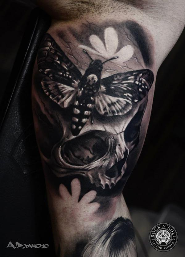 76-Skull with moths tattoo