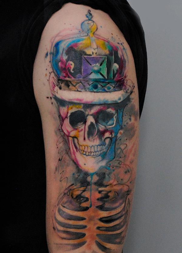 77-watercolor smile skull tattoo