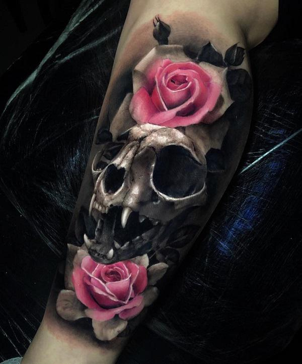 Calf tattoo with pink Roses and feline skull in black and grey style