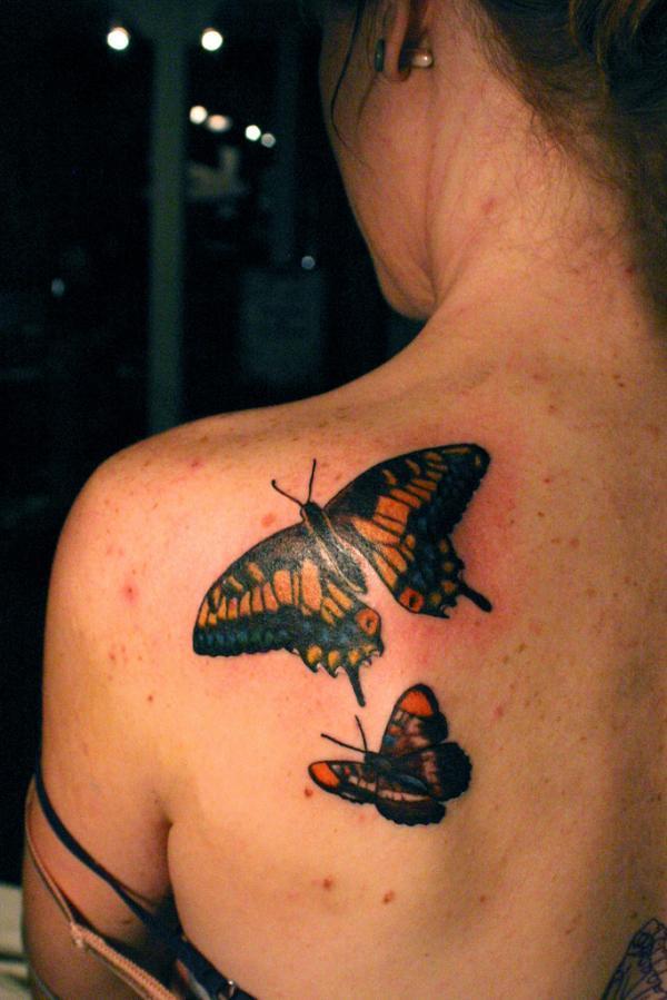 butterflies back tattoo