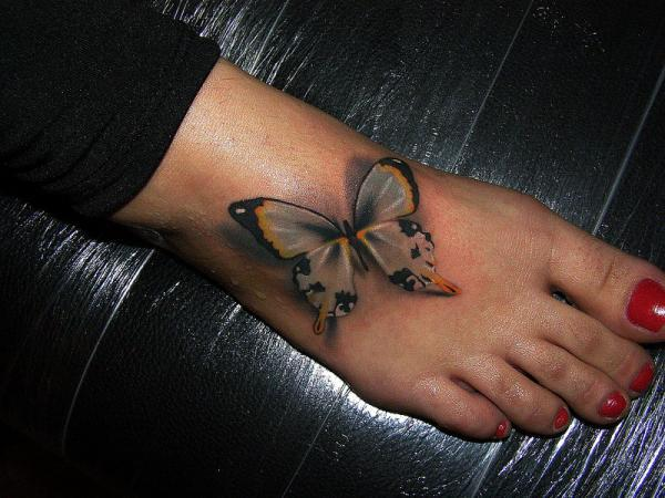 Tribal Butterfly Tattoo On Foot