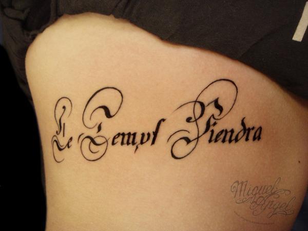 Lettering rib tattoo