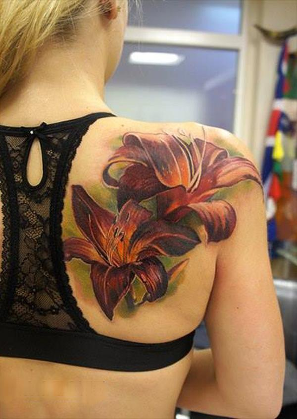 Realistic lily Tattoo on back by Andrey Grimmy