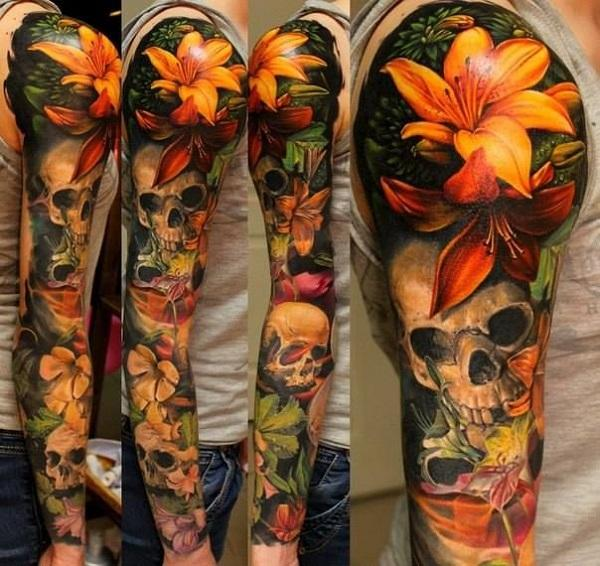 Realistic lily with skull tattoo on sleeve