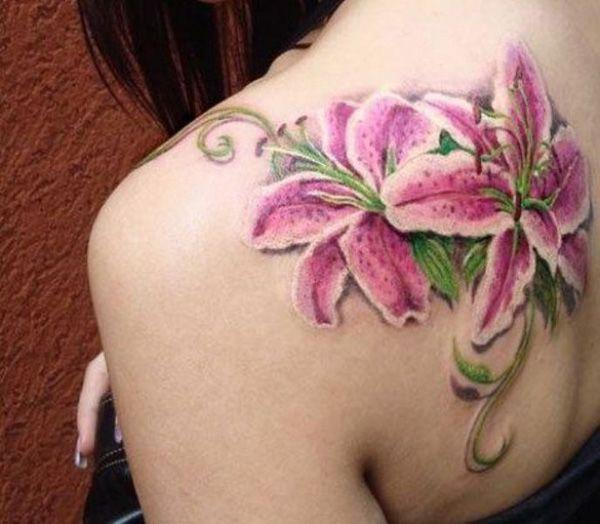Realistic pink lily tattoo on back