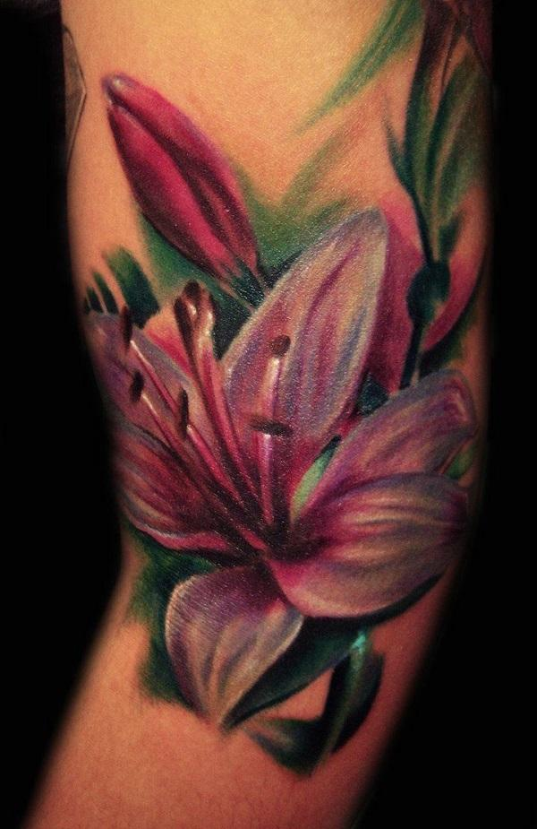Realistic pink lily tattoo on sleeve