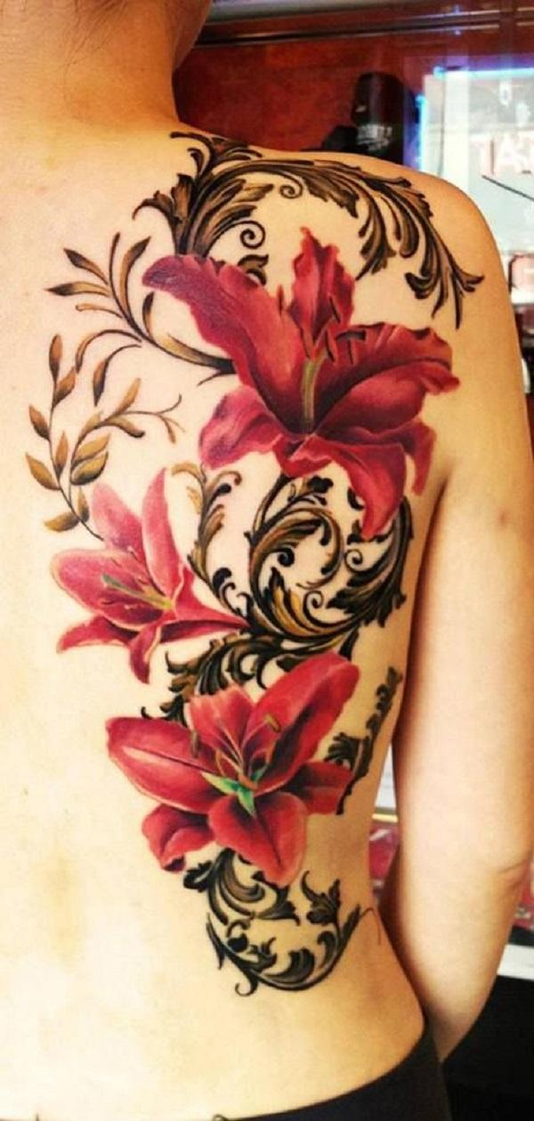 Red lily tattoo on back