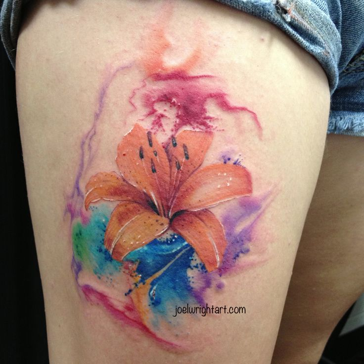 Watercolor lily tattoo on higth