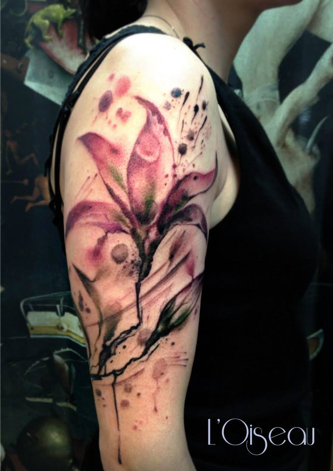 watercolor lily tattoo on sleeve by L'oiseau