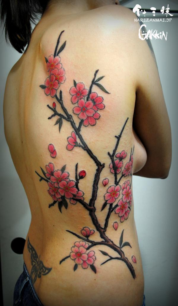 Cherry blossom side tattoo for women