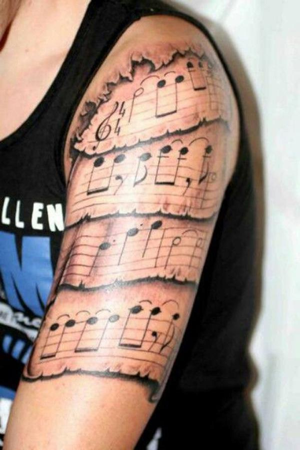 26 Music tattoo on sleeve