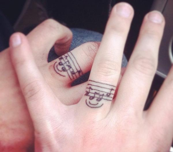 34 Music tattoo on finger
