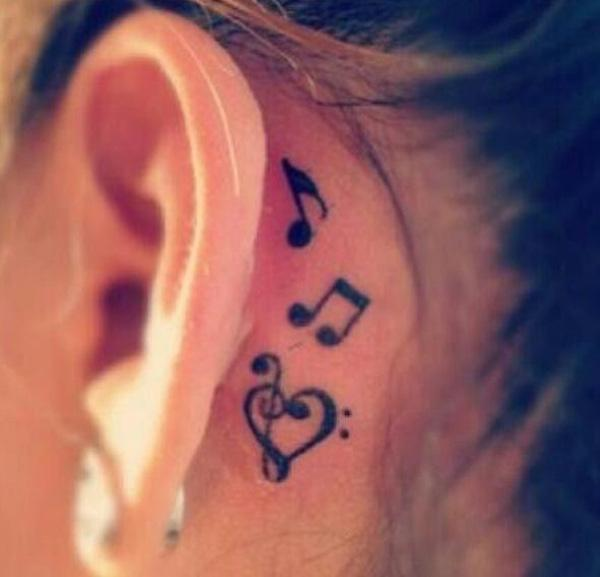 55 Music tattoo behind the ear