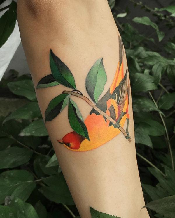amazing-bird-and-leaves-tattoo-97