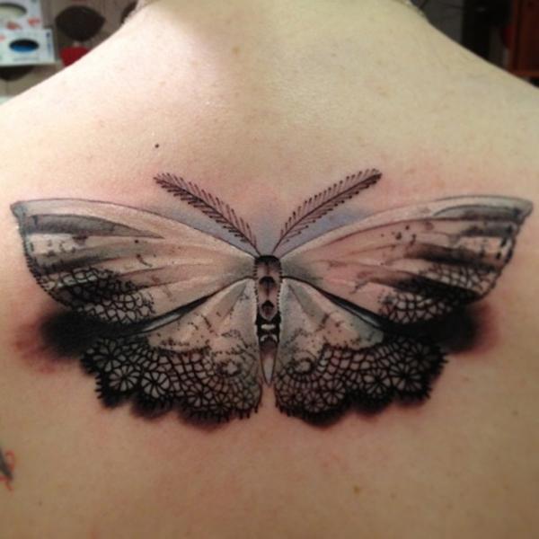 Realistic 3D moth tattoo on back