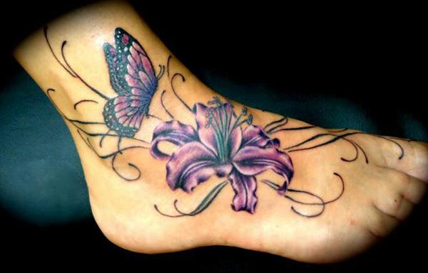 95792b472 butterfly and lily tattoo on foot - 50 Awesome Foot Tattoo Designs <3 <3 ...