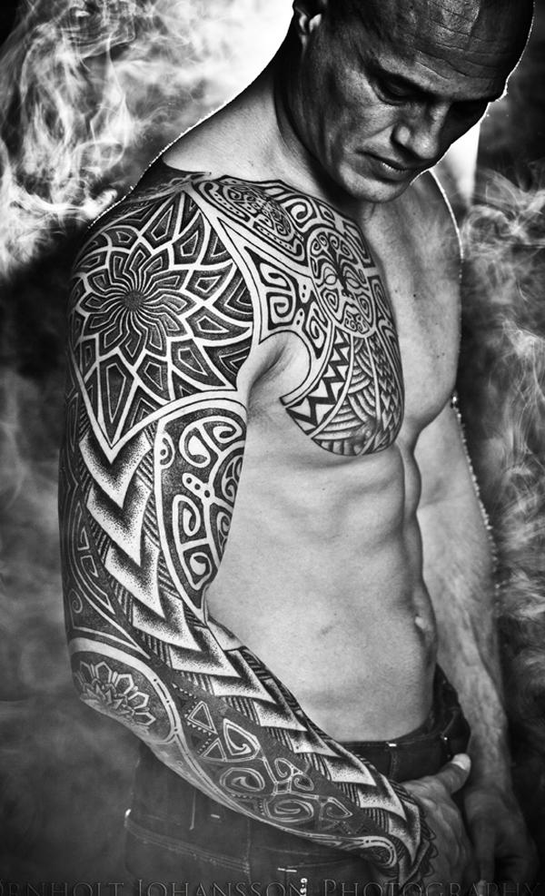 The Titan sleeve tattoo tribal black and white color makes it deep and masculine style