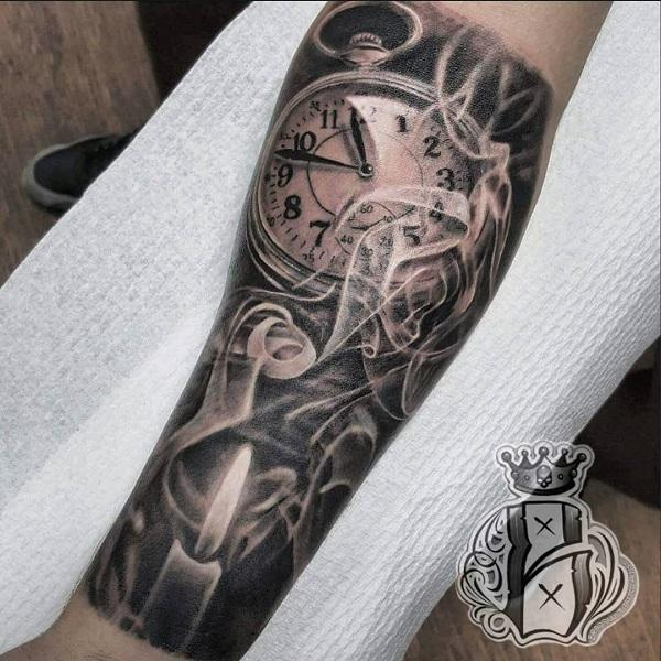 watch-and-candle-forearm-tattoo-79