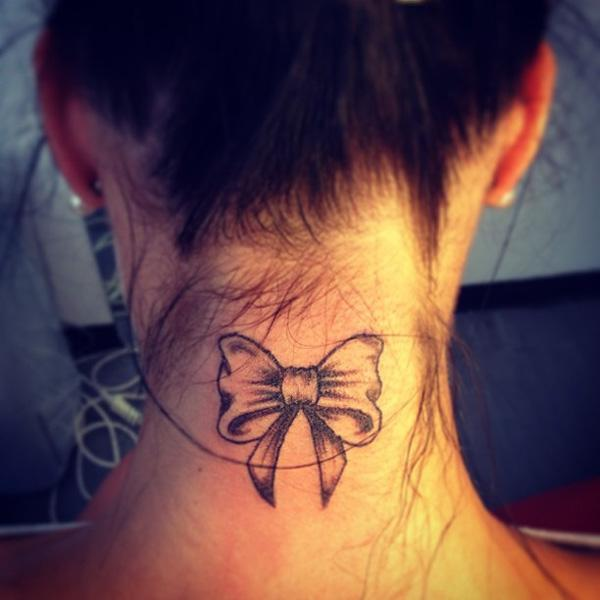 Small ribbon neck tattoo