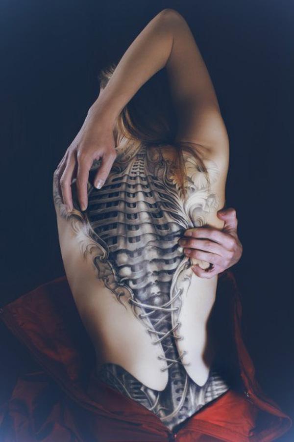 Frightful open spine back tattoo