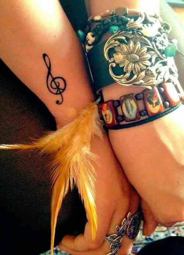 Small music note tattoo