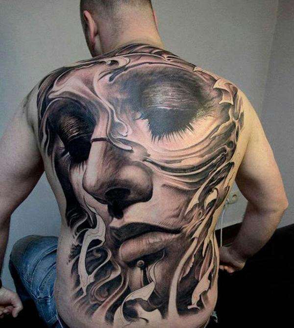 Melting Portrait full back tattoo