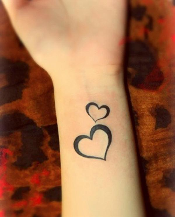 Small heart symbols tattoo