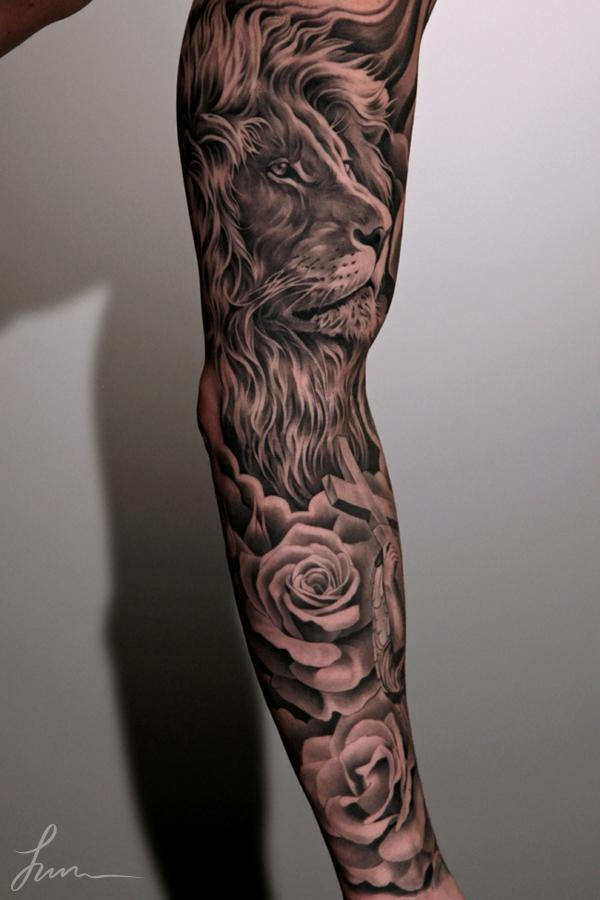 Lion and roses sleeve tattoo