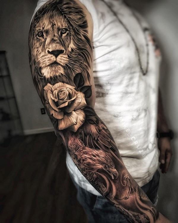 Lion rose and bird full sleeve tattoo