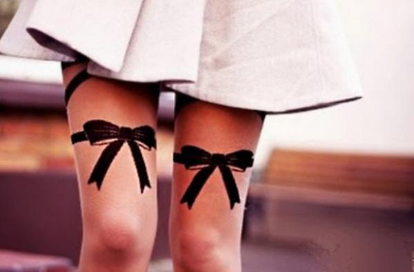 Бантики на ногах тату значение